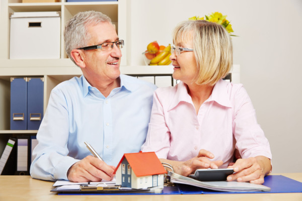 Husband and wife discussing a living trust or revocable trust